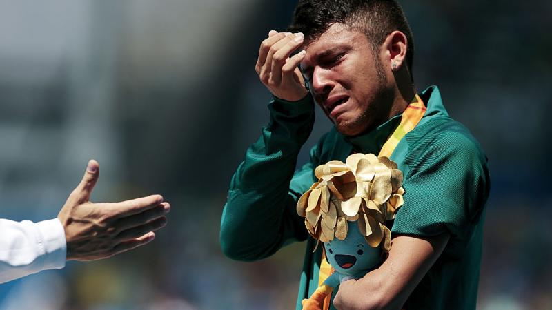 a Para athlete cries on the podium