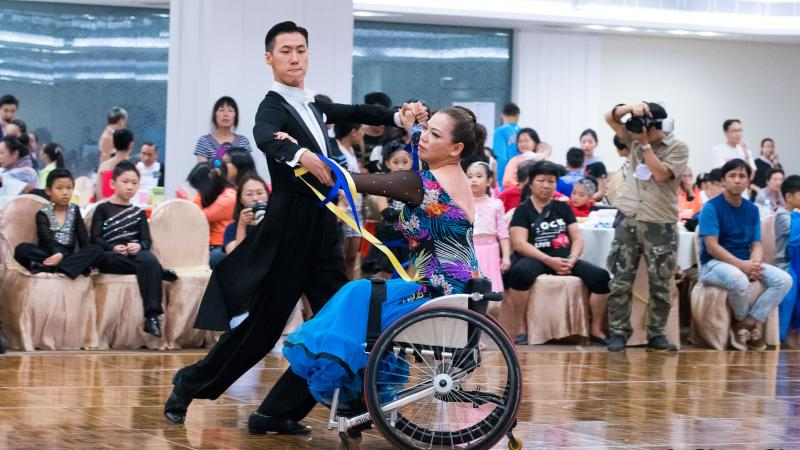 Woman in wheelchair dances with standing partner