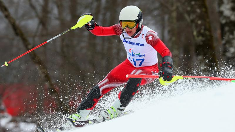 a male Para skier goes down the slope