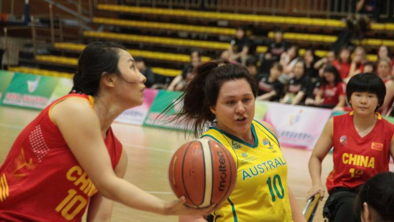 female wheelchair basketball players battle for the ball