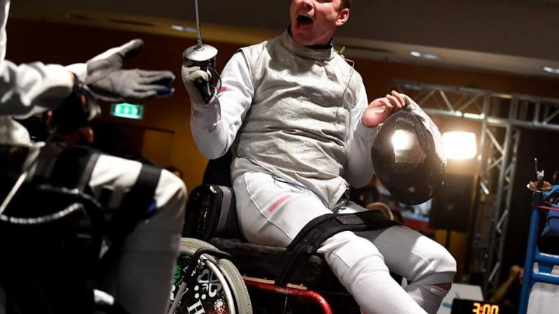 a wheelchair fencer celebrates his victory