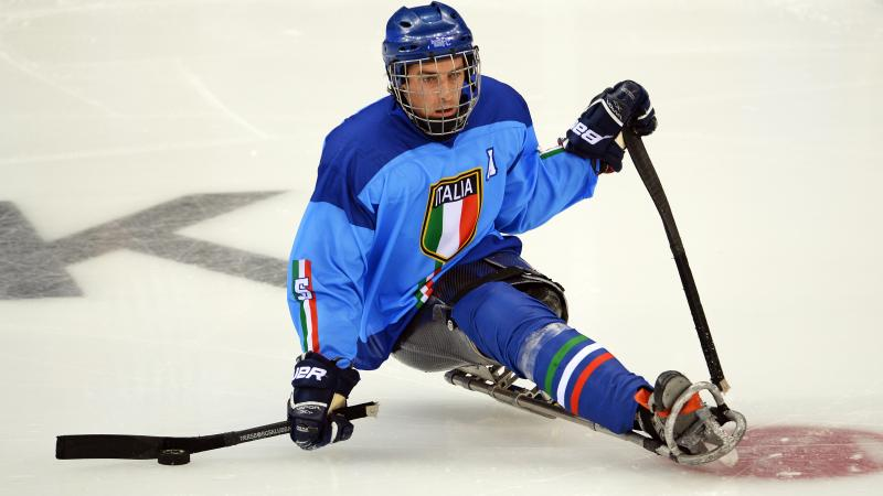 a male Para ice hockey player on the ice