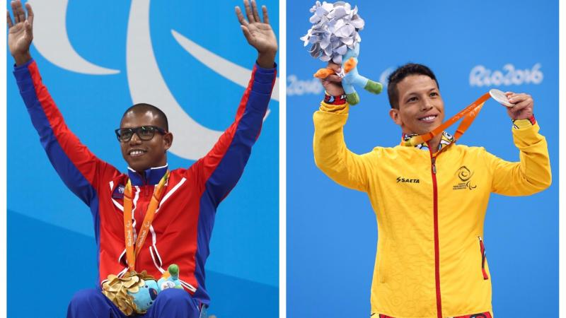 two male Para swimmer raise their arms on the podium