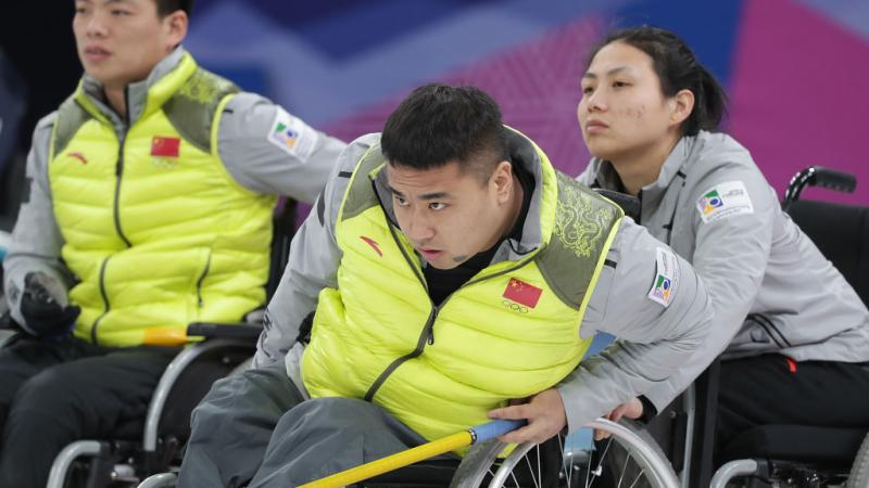 a male wheelchair curling player