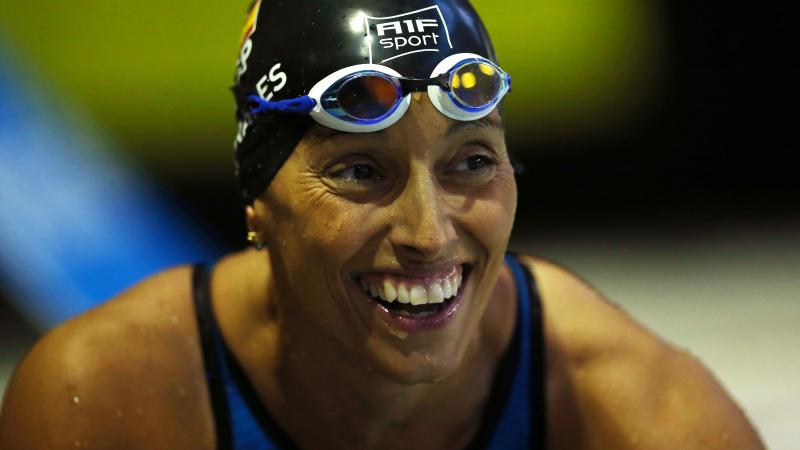 a female Para swimmer smiling in the pool