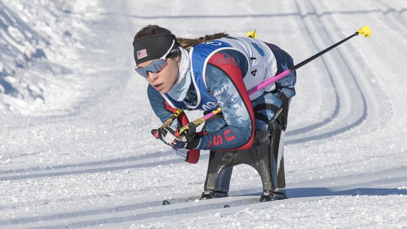 Oksana Masters skiing on a sit-ski