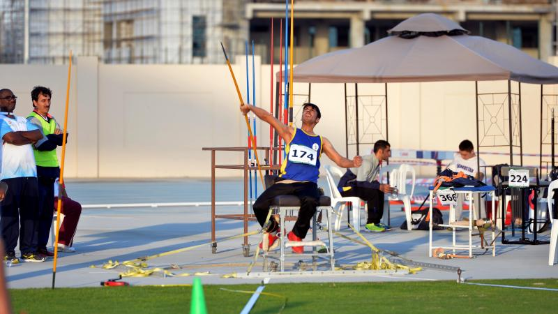a male Para athlete throws a javelin