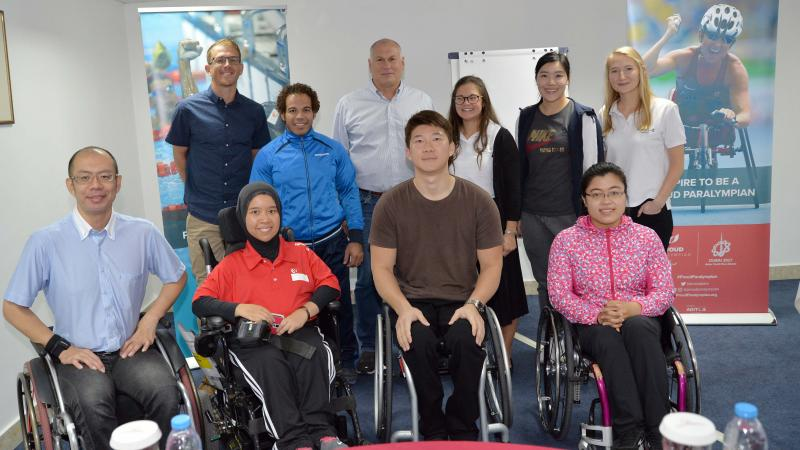 Seven new Proud Paralympian leaders pose with the workshop educators in Dubai