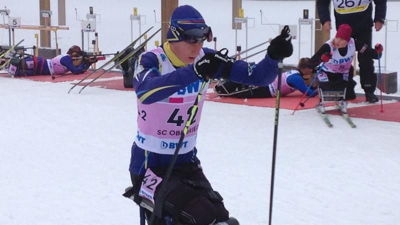 Athlete on a sit skiing racing