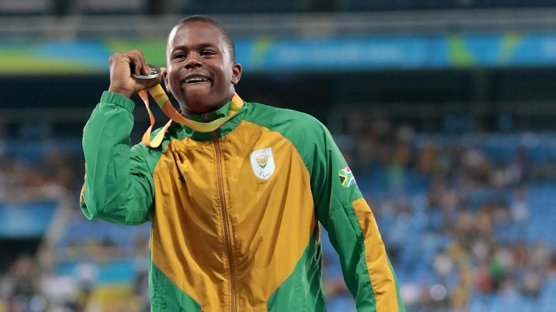 Silver medalist Ntando Mahlangu of South Africa celebrate on the podium at the medal ceremony for the Men's 200m T42 Final at the Rio 2016 Paralympic Games.