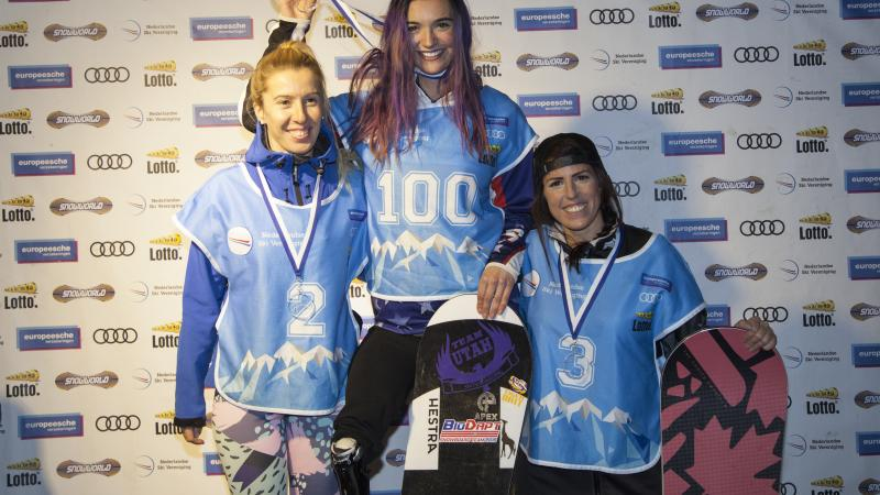 three female Para snowboarders on the podium