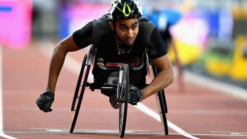 Walid Ktila of Tunisia crosses the line to win the Mens 200m T34 final at the London World Para Athletics Championships.