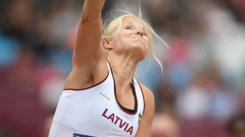 Female Para athlete Diana Dadzite of Latvia throws a shot put