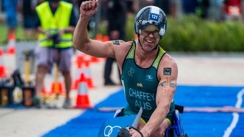 Triathlete celebrates crossing finishing line