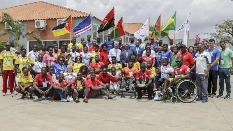 Around 50 participants of Agitos Foundation training camp pose for a group picture in Luanda, Angola