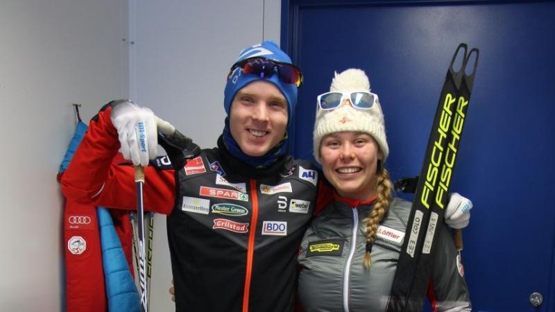 a male and female Para Nordic skier smiling together