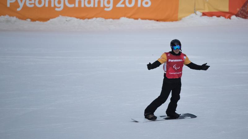 Athlete competing in snowboard