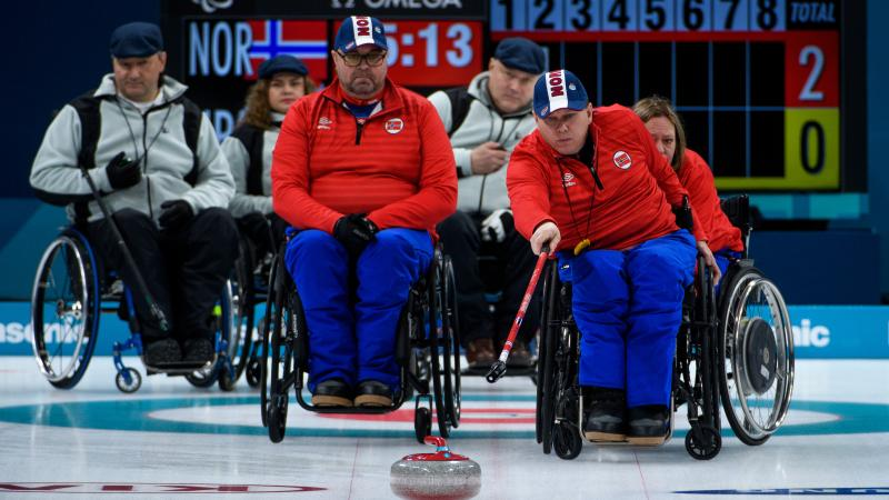 a wheelchair curler plays a stone