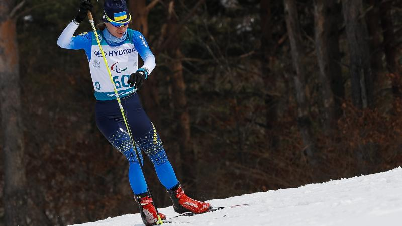 a female standing Nordic skier