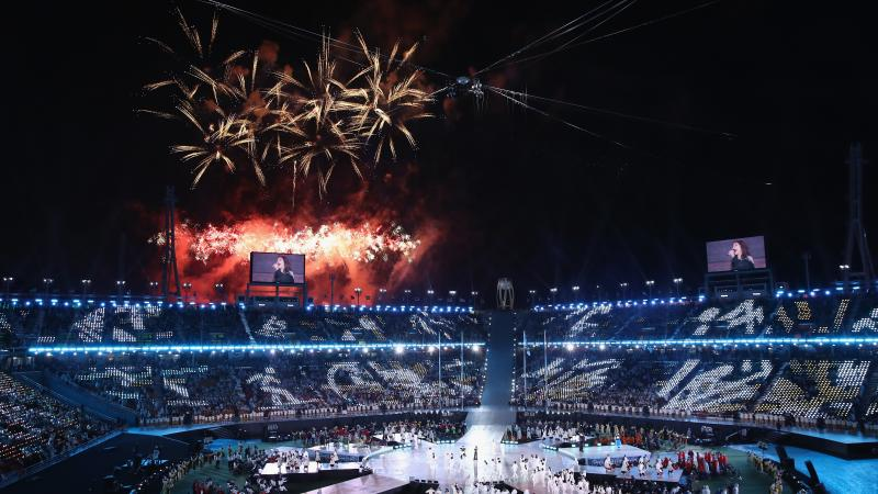 a stadium with fireworks exploding above it