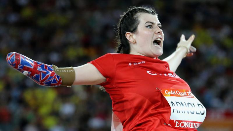a female thrower screams as she throws her javelin