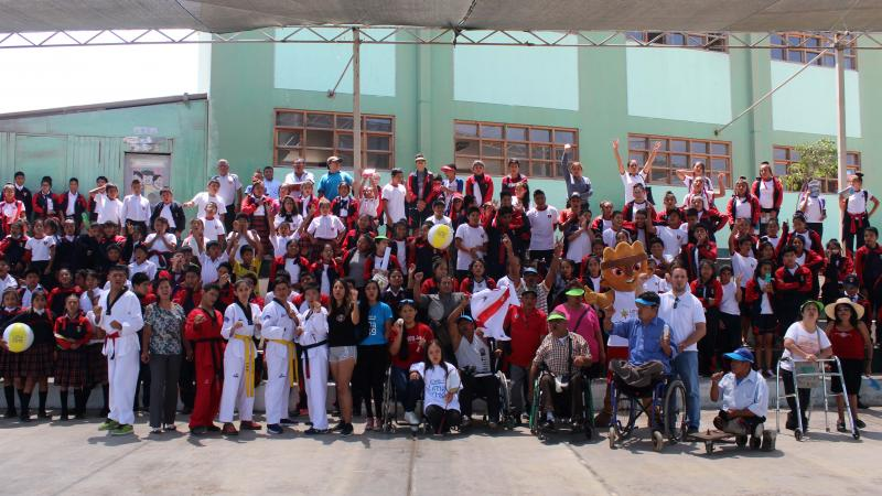 a group of Para athletes and schoolchildren