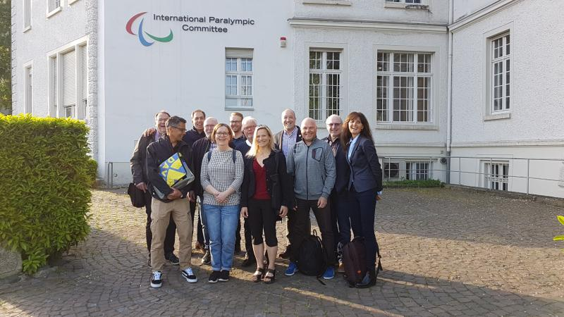 Group of people standing for picture in front of the IPC headquarters in Bonn