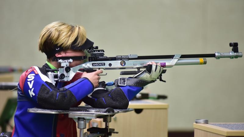 a female Para shooter taking a shot