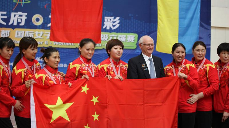 Chinese women's sitting volleyball team celebrates after winning gold at World Super 6