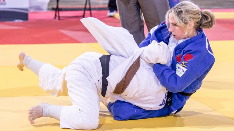 two female judokas in action on the mat