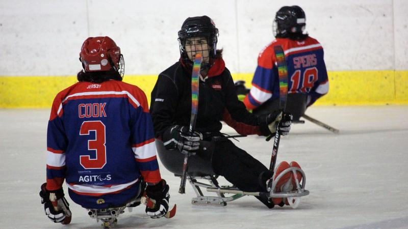 Para ice hockey athlete talks to coach during training camp in Czech Republic