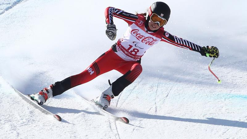 a female Para alpine skier skies down the slope