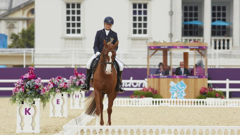 a female Para equestrian rider on her horse performing dressage