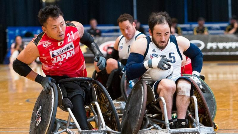 two male wheelchair rugby players clash on the court