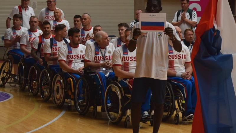 a group of male wheelchair basketball players