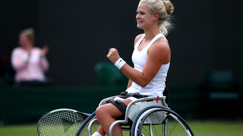 female wheelchair tennis player Diede de Groot plays a shot on grass