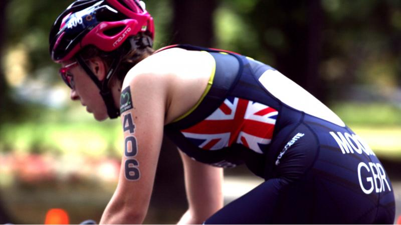 British female triathlete Hannah Moore riding on her bike during a race