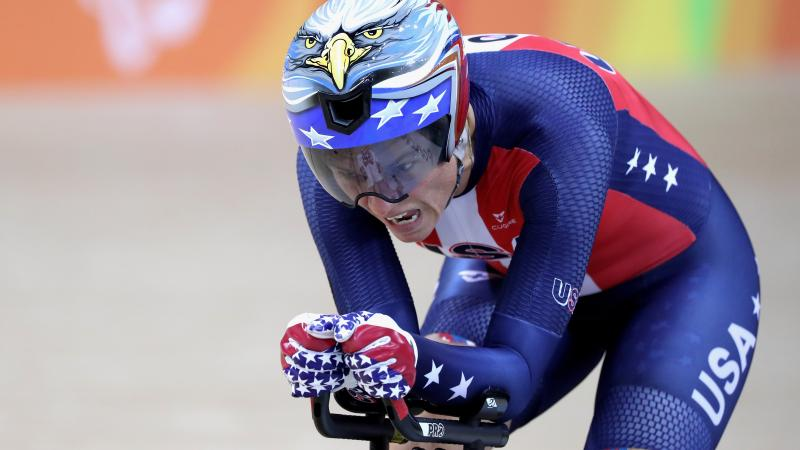 female Para cyclist Shawn Morelli rides towards the finish line on her bike