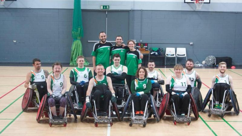 the Ireland male and female wheelchair rugby team smiling on a court