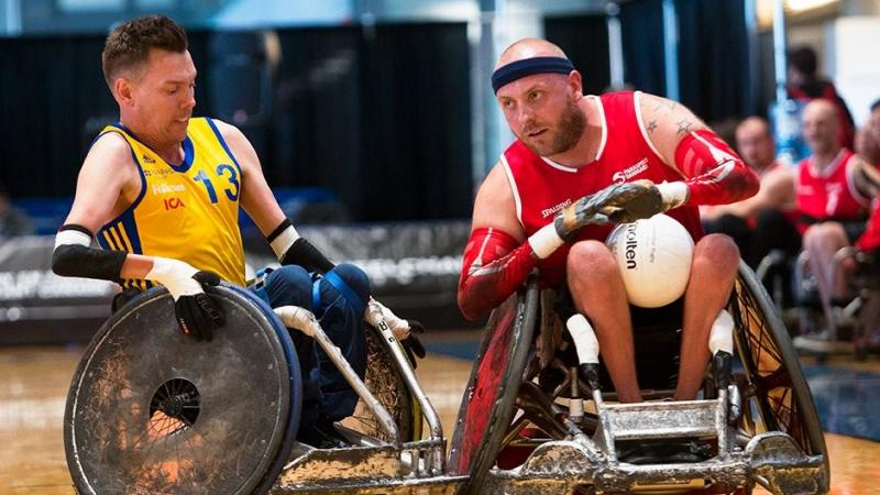 male wheelchair rugby player Stefan Jansson tackles another player