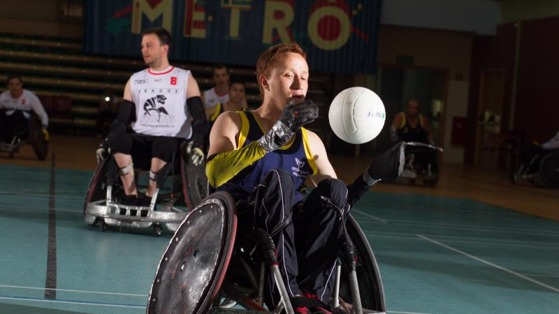 male wheelchair rugby player Carlos Neme with the ball