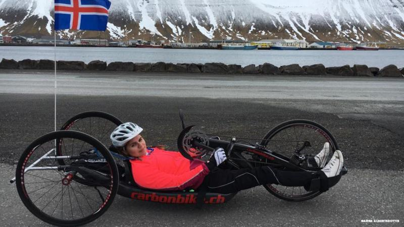female Para cyclist Arna Albertsdottir in action on the road