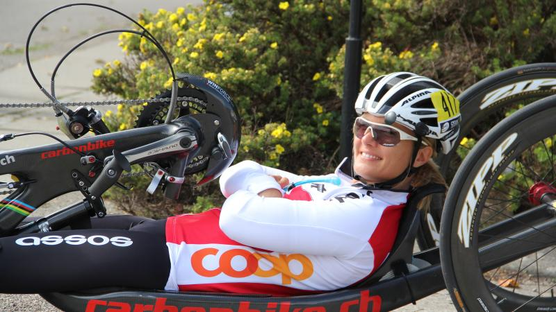 female Para cyclist Ursula Schwaller using a hand bike on the road