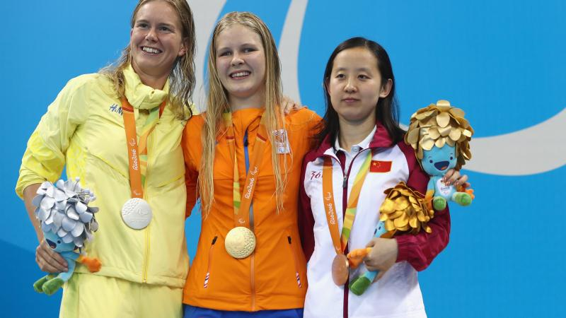 three female Para swimmers including Liesette Bruinsma and Maja Reichard on the podium with their medals