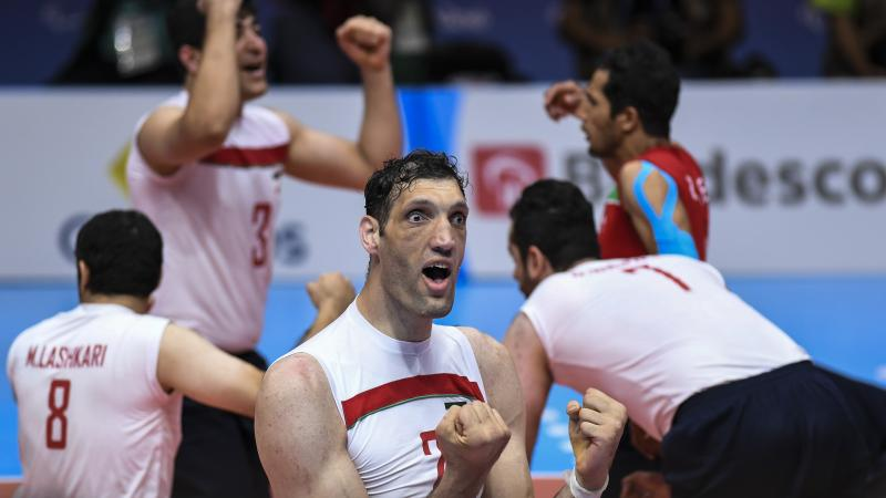 male sitting volleyball player Morteza Mehrzadselakjani celebrating a point