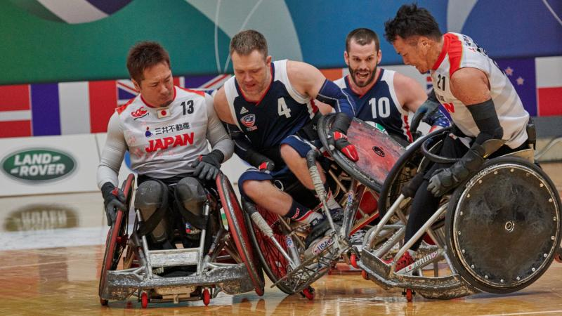 male wheelchair rugby players from USA and Japan clash on the court
