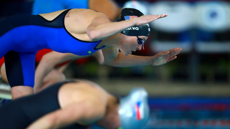 female Para swimmer Jessica Long dives into the swimming pool