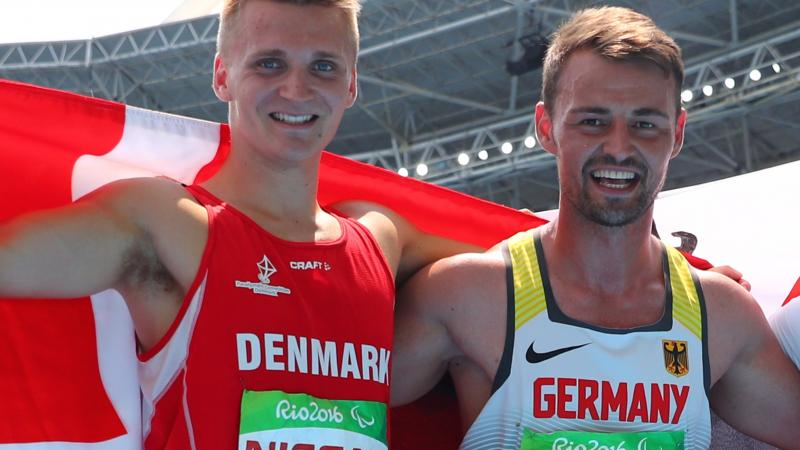 male Para athletes Daniel Wagner and Heinrich Popow smiling with their arms around eachother