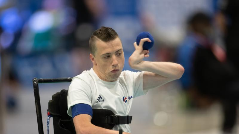 male boccia player David Smith plays a shot