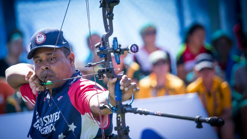 male Para archer Andre Shelby prepares to shoot an arrow